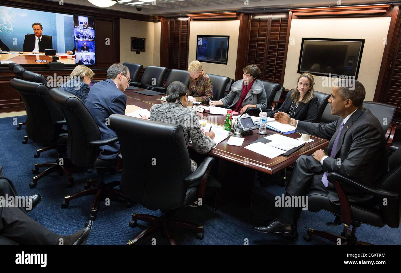 US President Barack Obama participates in a secure video teleconference with foreign leaders to discuss Ukraine and global security issues in the Situation Room of the White House March 3, 2015 in Washington, DC. Participants include Prime Minister David Cameron of the United Kingdom, President Franois Hollande of France, Chancellor Angela Merkel of German, Prime Minister Matteo Renzi of Italy and European Council President Donald Tusk. Stock Photo