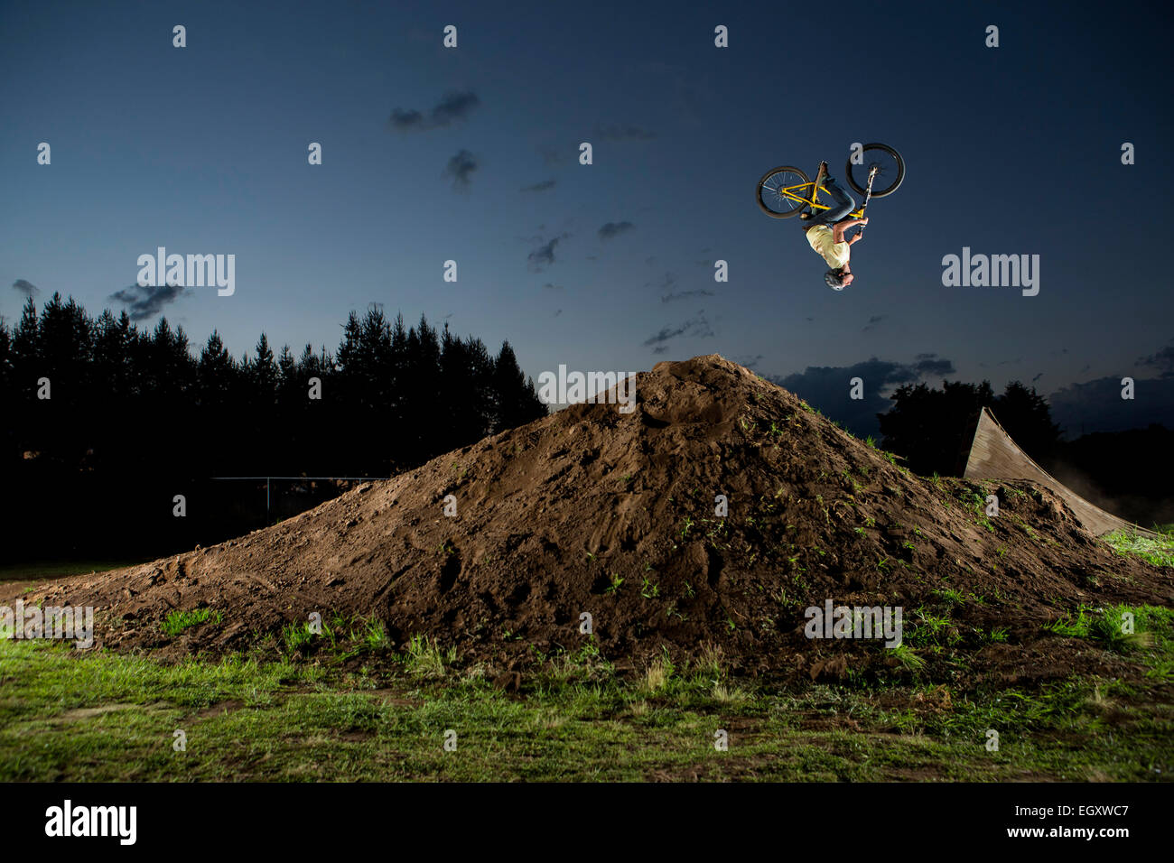 A young man performs dirt jumps near Toluca, Mexico - Stock Image