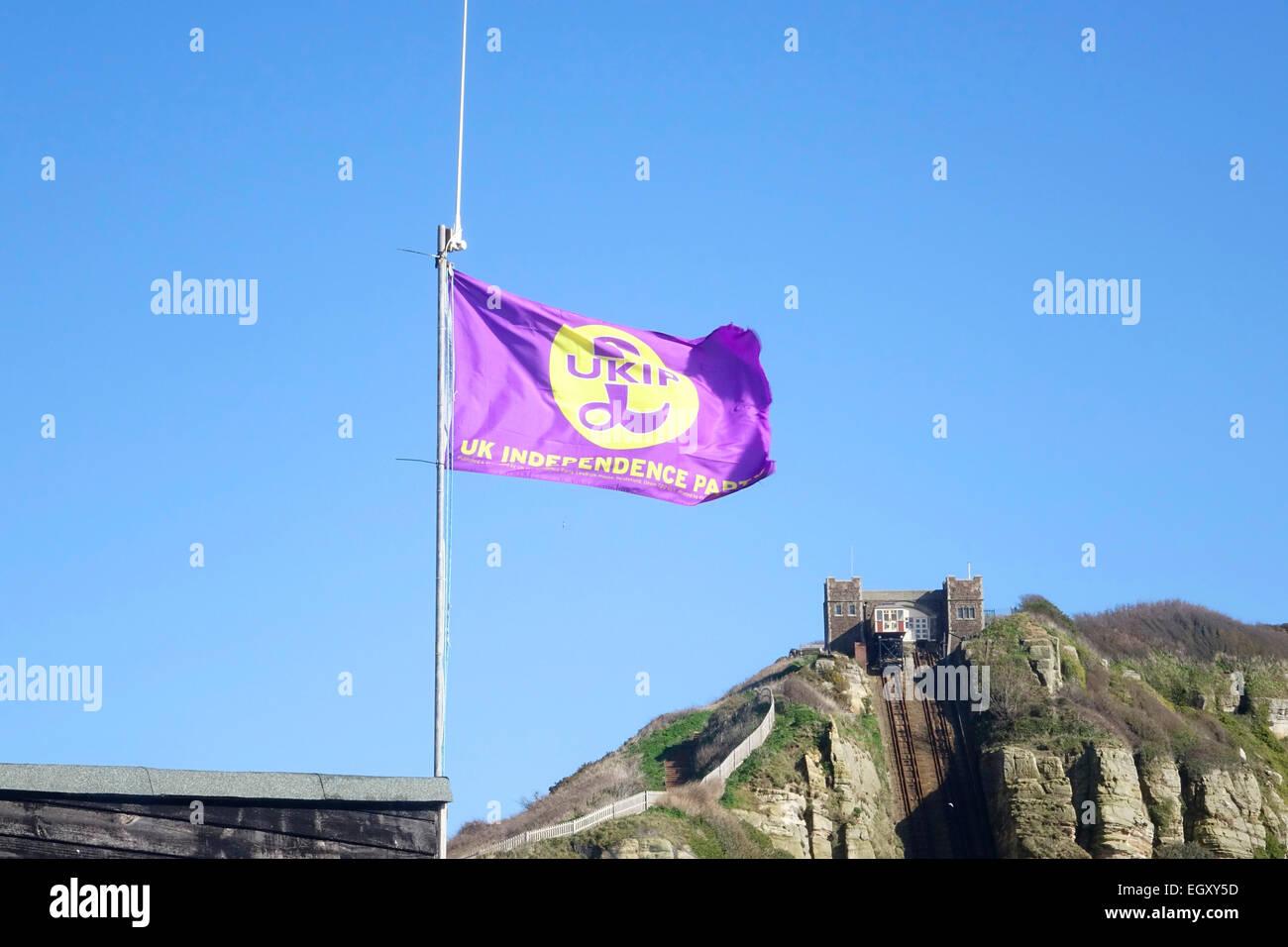 UKIP Flag flying on Hastings Stade fishermen's beach, East Sussex, GB - Stock Image