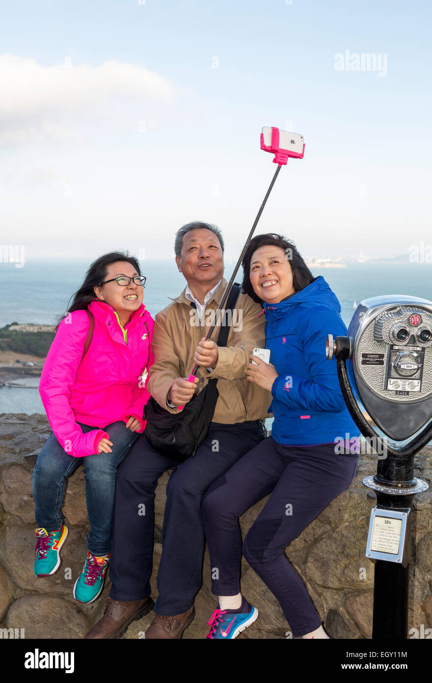 tourists, family, taking selfie, selfie photo, selfie stick, cellphone, Vista Point, north side of Golden Gate Bridge, - Stock Image