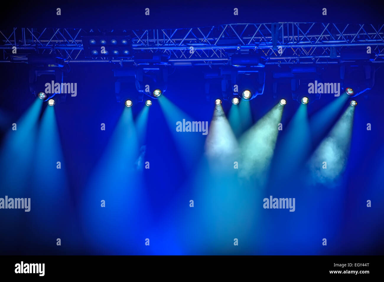 Blue stage spotlights hanging on lighting pipe systems - Stock Image