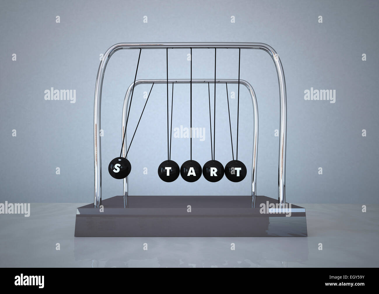Newton's cradle with word START written on it - Stock Image