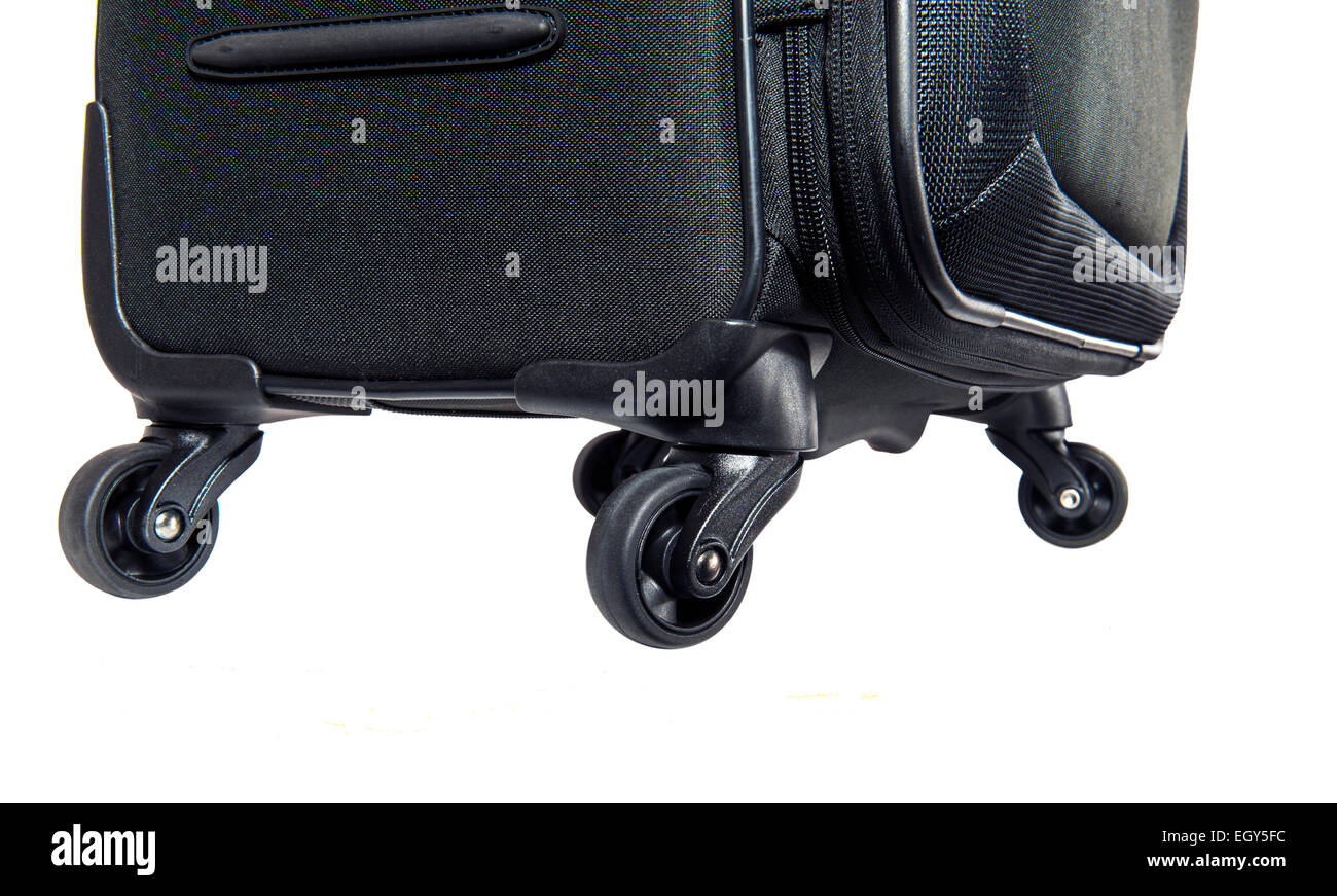 Close up of the wheels on a four wheeled suitcase - Stock Image
