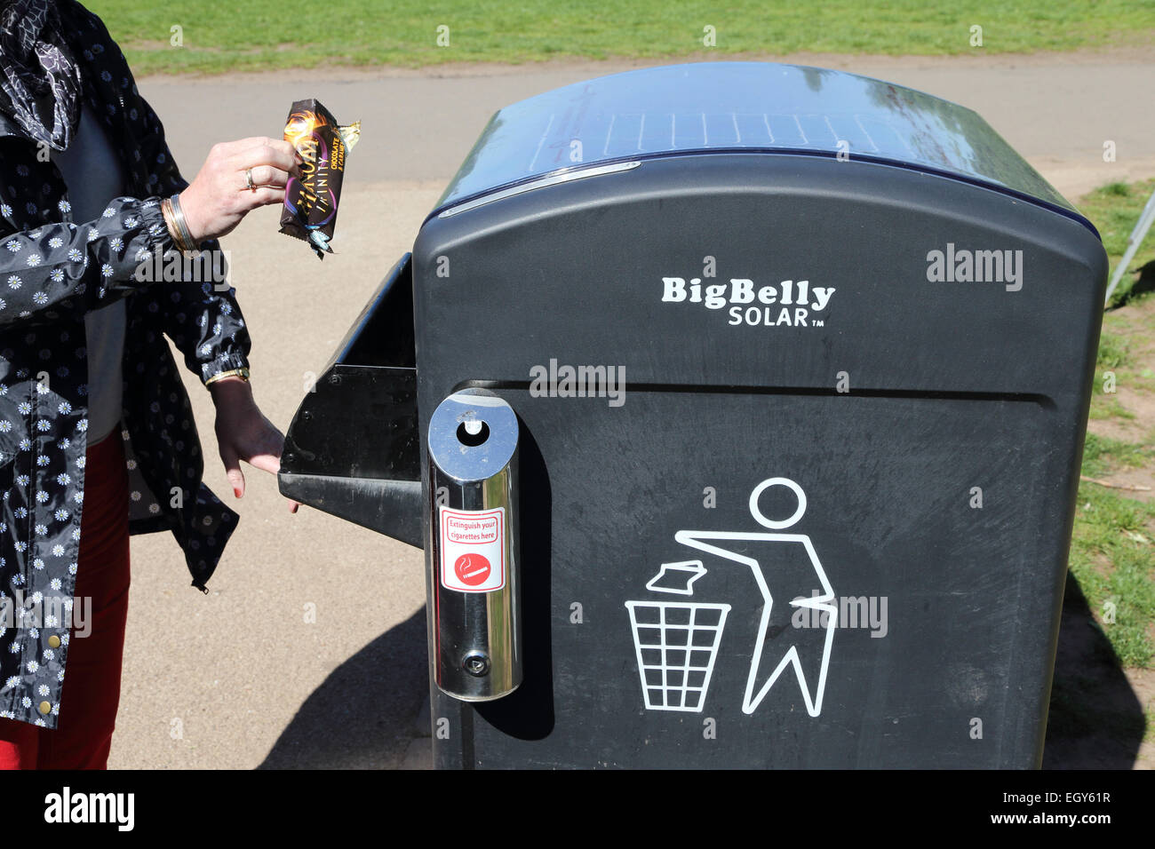 Solar powered waste bin which periodically compresses its contents so it does not need emptying so frequently. - Stock Image