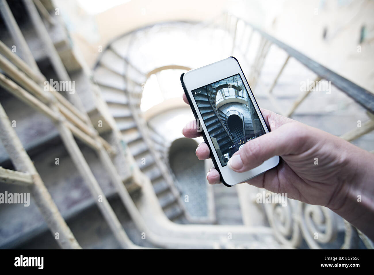 Woman's hand holding smartphone taking a picture Stock Photo