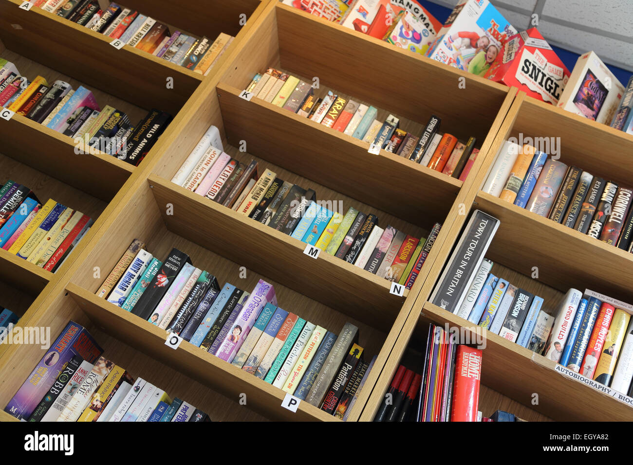 Shelves of books at a public library. - Stock Image