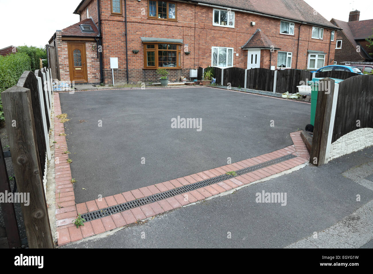 Front garden paved over for car parking. Nottingham - Stock Image