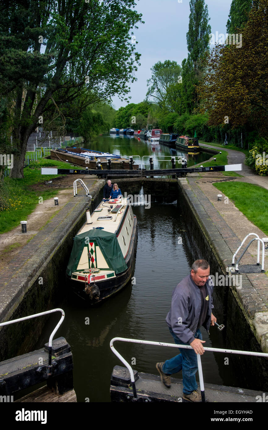 Barge docked in canal lock - Stock Image