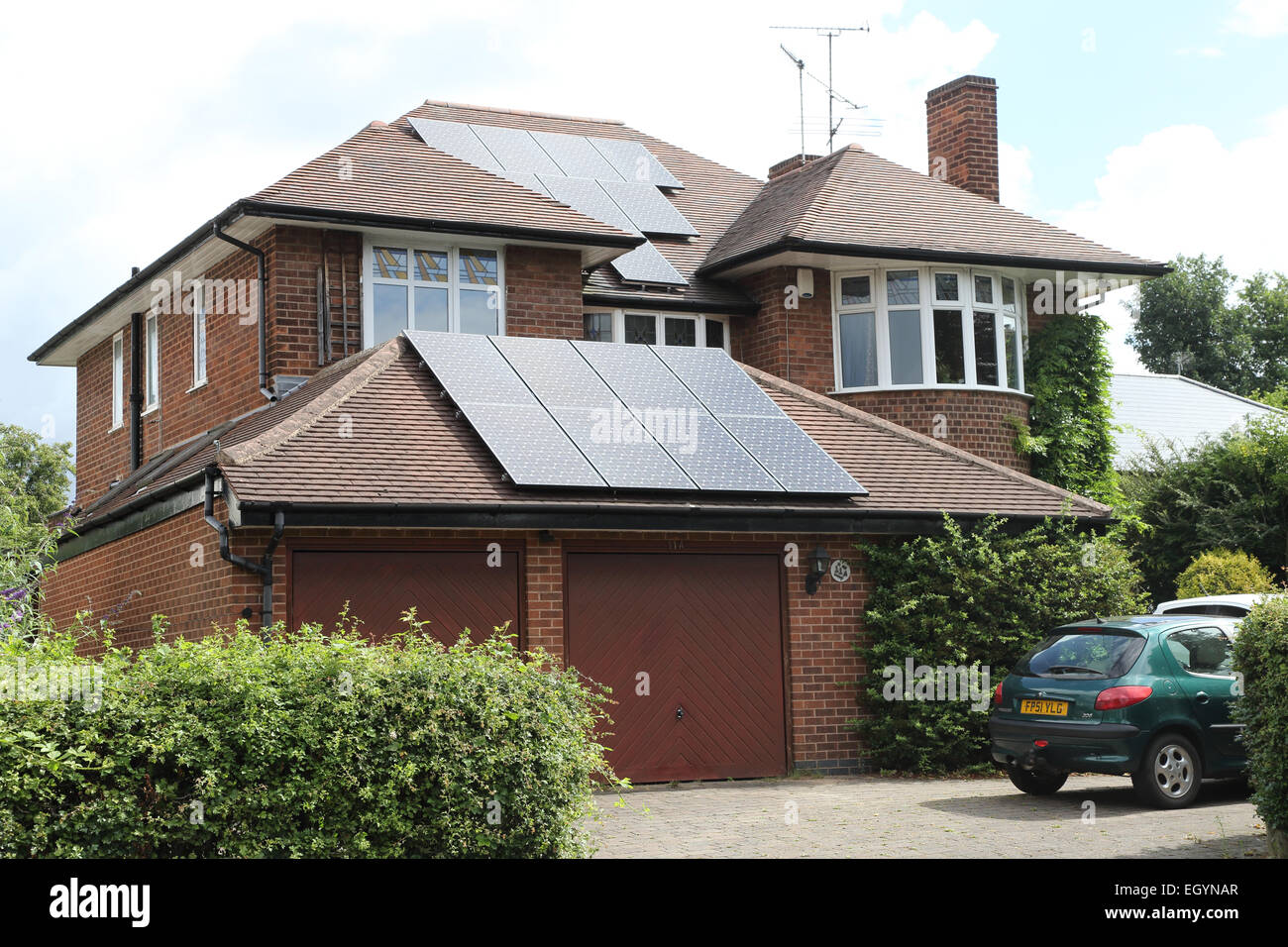 Solar panels on detached house - Stock Image