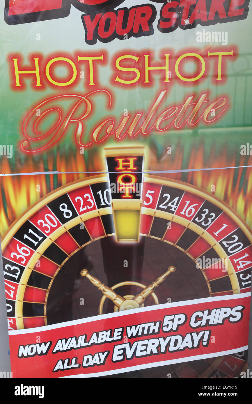 Sign advertising roulette outside amusement arcade - Stock Image