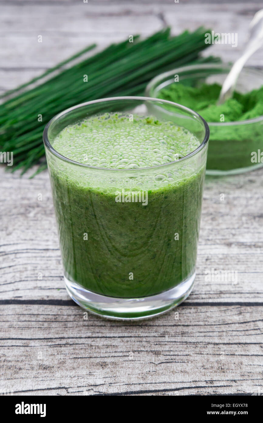 Glass of wheatgrass smoothie - Stock Image