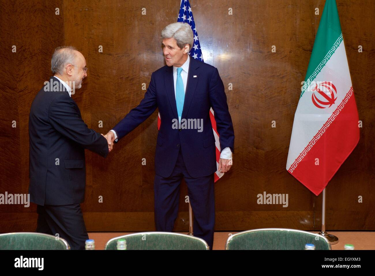 US Secretary of State John Kerry shakes hands with Dr. Ali Akbar Salehi, the Vice President of Iran for Atomic Energy - Stock Image