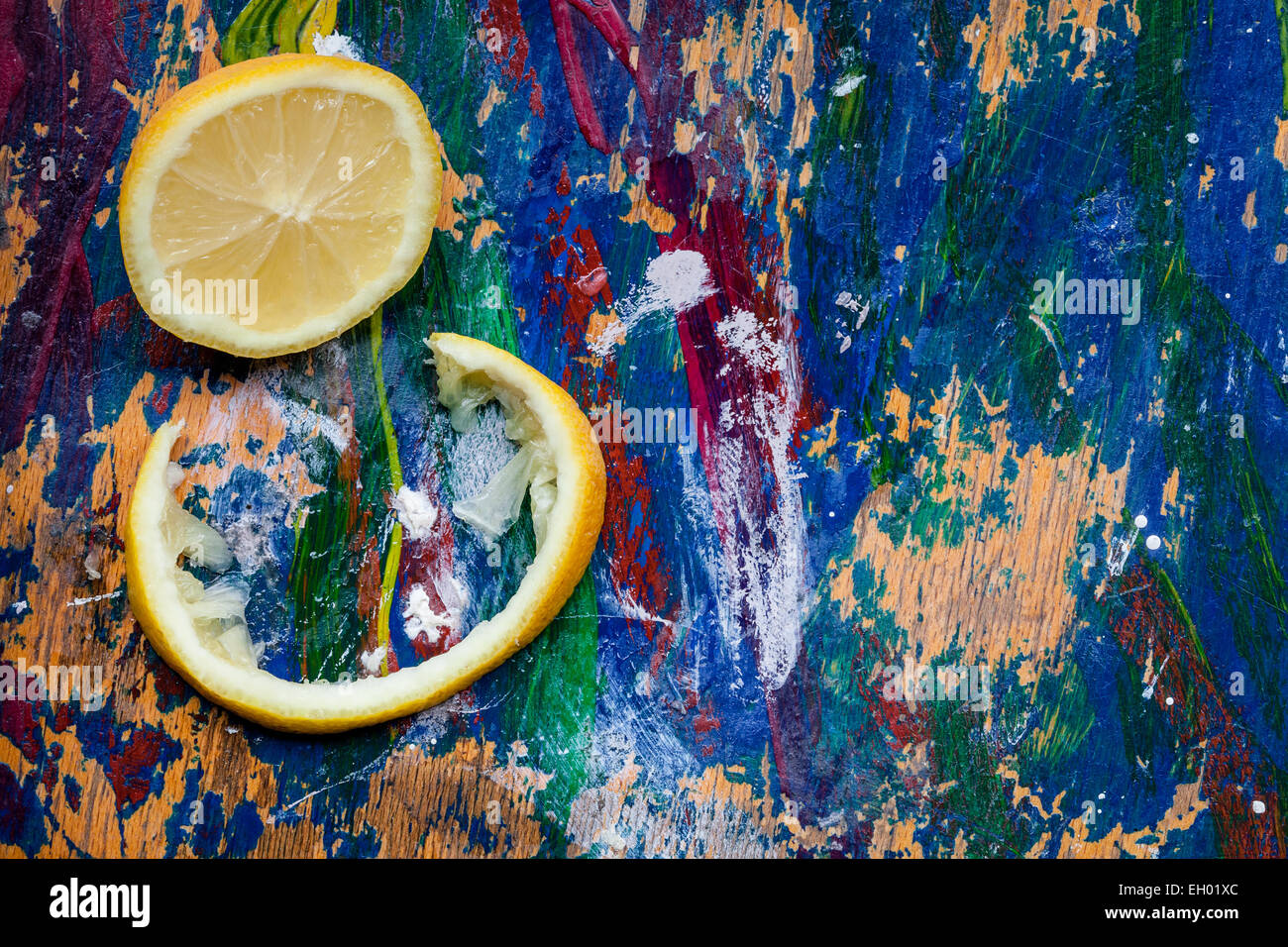 Lemon parts arranged on a colourful background, plenty of room for your text - Stock Image