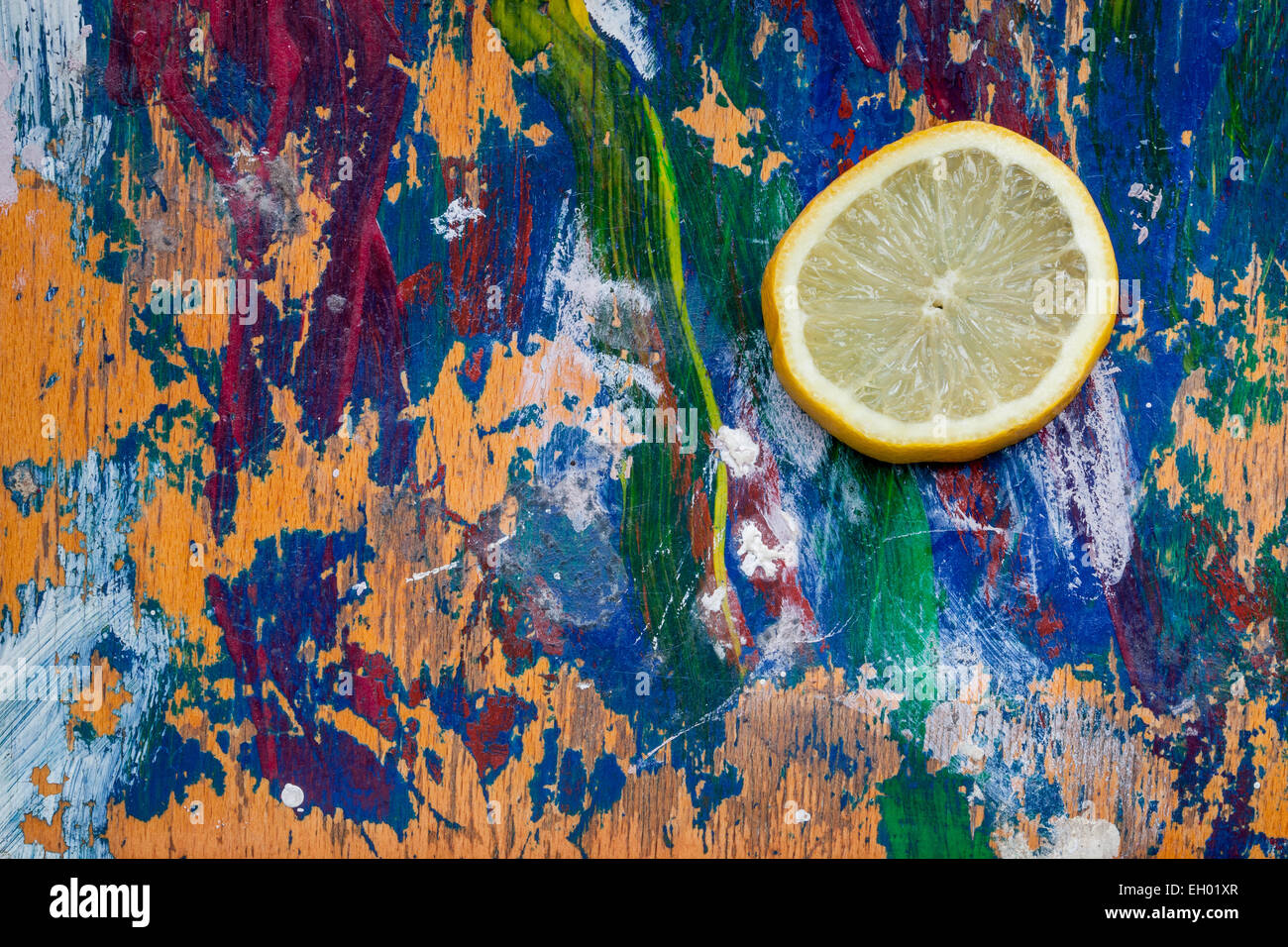 Lemon slice on a colorful background, plenty of room for your text - Stock Image
