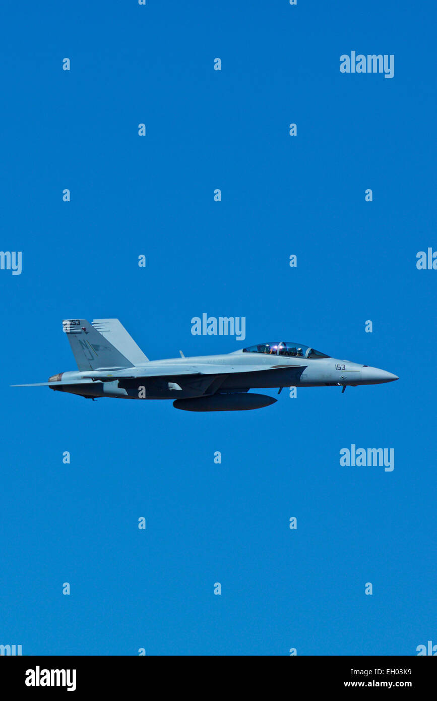 Close Up Profile View Of A US Navy F/A-18F Super Hornet Jet Fighter Flting In The Skies Above California. Stock Photo