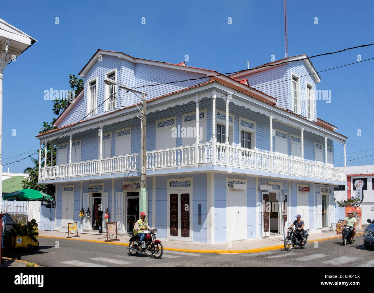 Colonial Victorian old wooden building containing shops on Calle Beller Street, San Felipe de Puerto Plata, Dominican - Stock Image