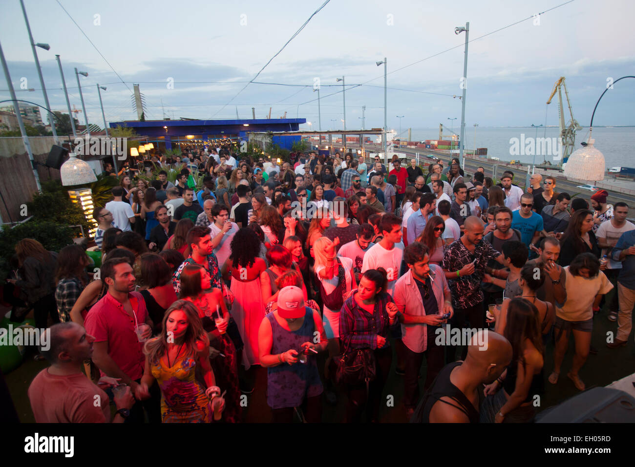 People dancing at a DJ party at Clube Ferroviario (Railway Club), in Lisbon, Portugal. - Stock Image