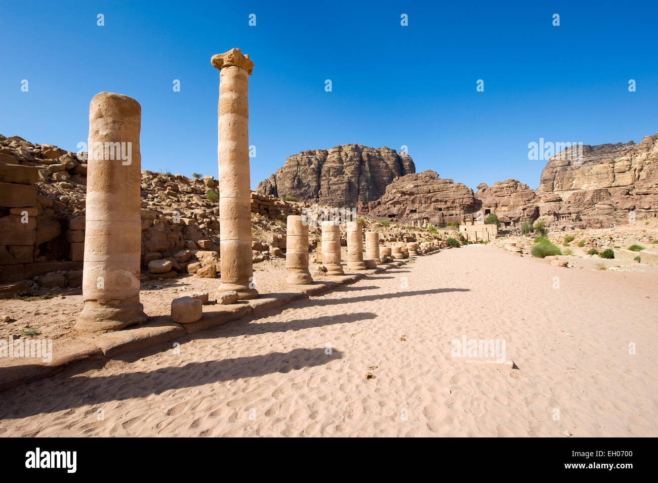 Roman pillars in the colonnaded street in Petra in Jordan - Stock Image