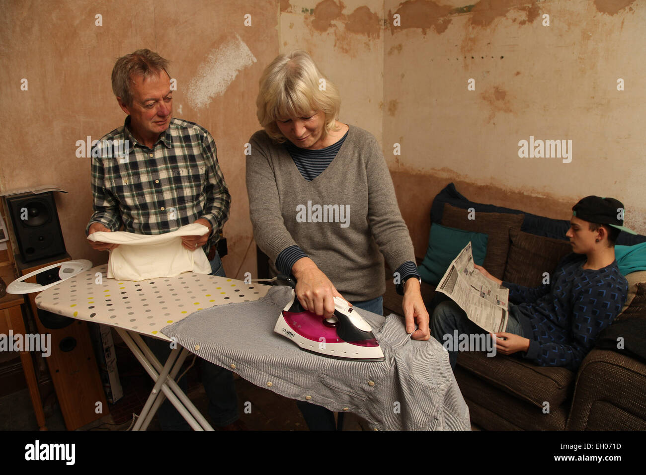 Teenager with grandparents and ironing - model released - Stock Image