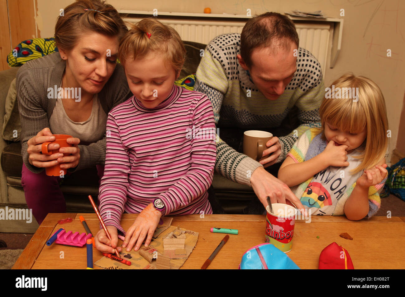 Parents and children crafting - Stock Image
