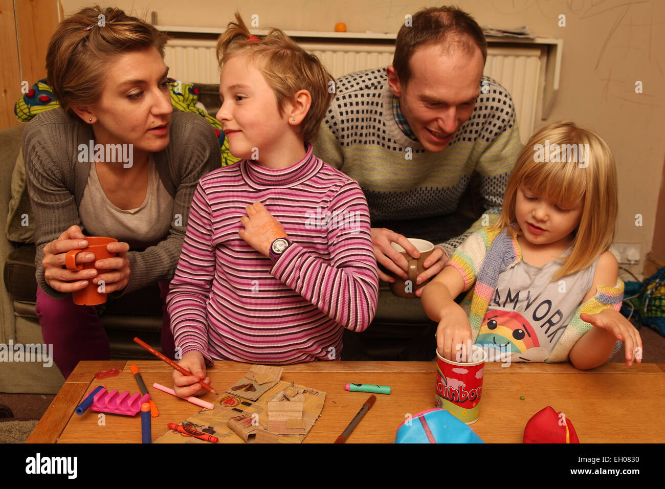 Parents and children crafting - model released Stock Photo