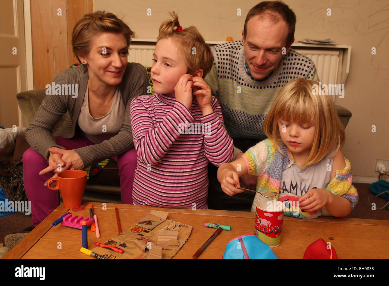 Parents and children crafting - model released - Stock Image