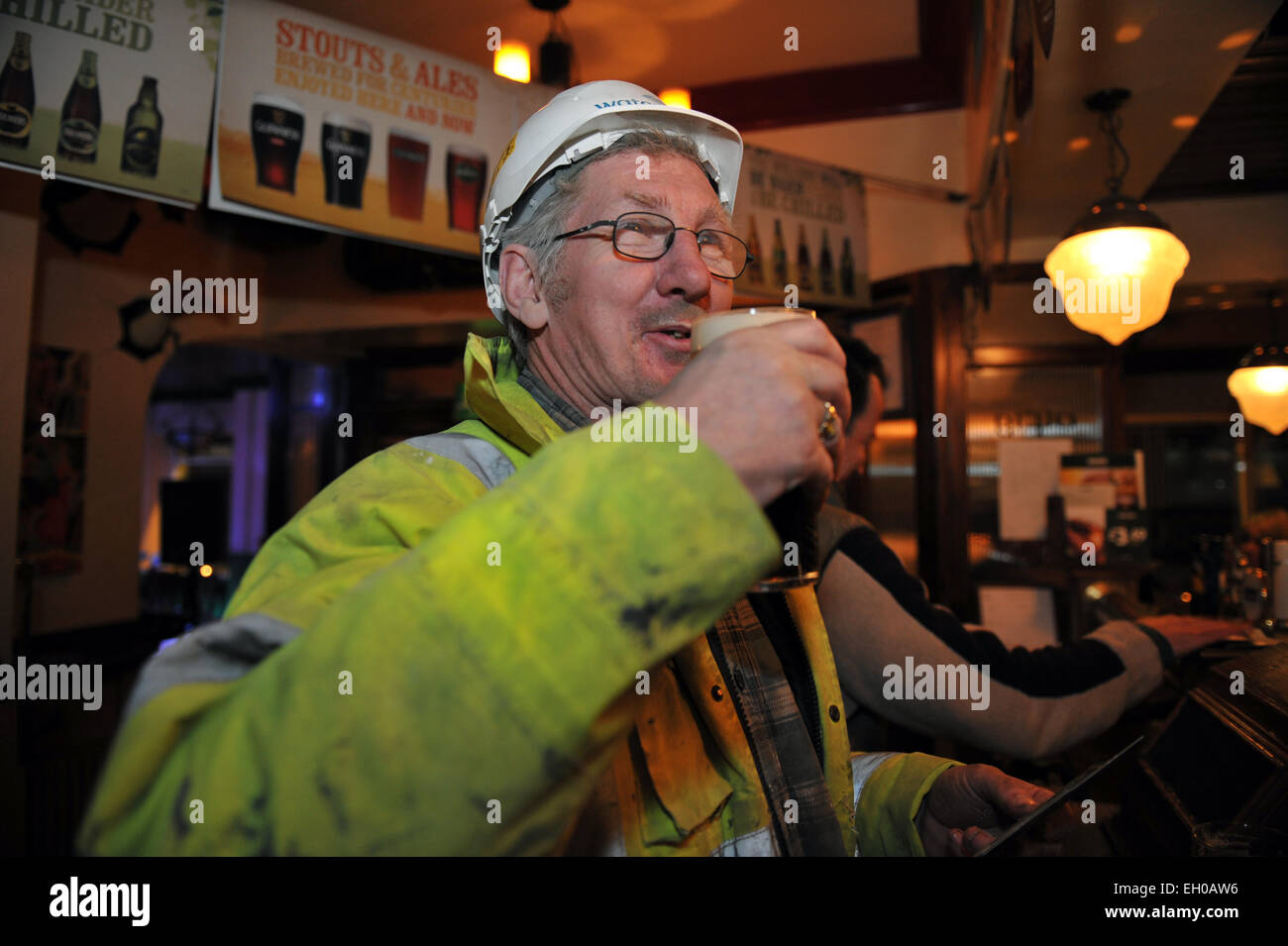 Working man enjoys a pint at the end of his shift, Yorkshire UK - Stock Image