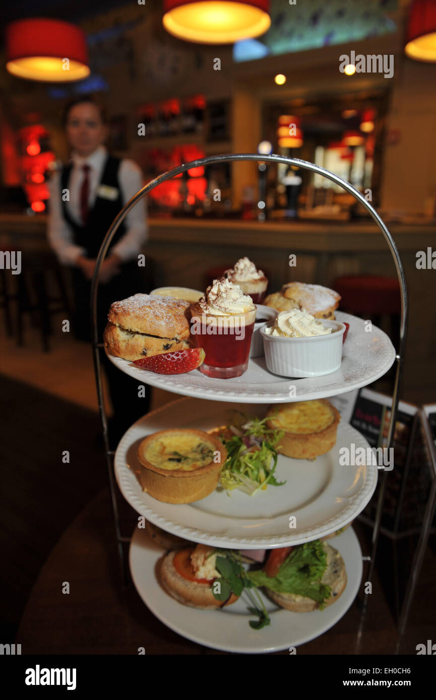 Tray of afternoon tea is served in the bar of a hotel, Yorkshire - Stock Image