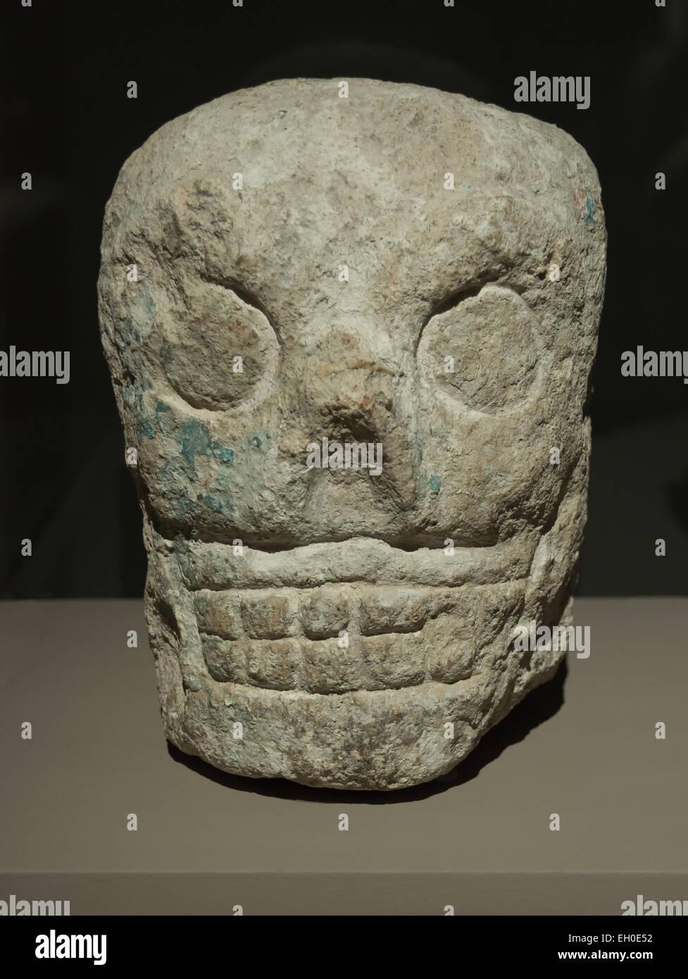 Decorative sculpture of a Maya skull, old post classic era (900 - 1250 CE), limestone. Yucatan, Mexico - Stock Image