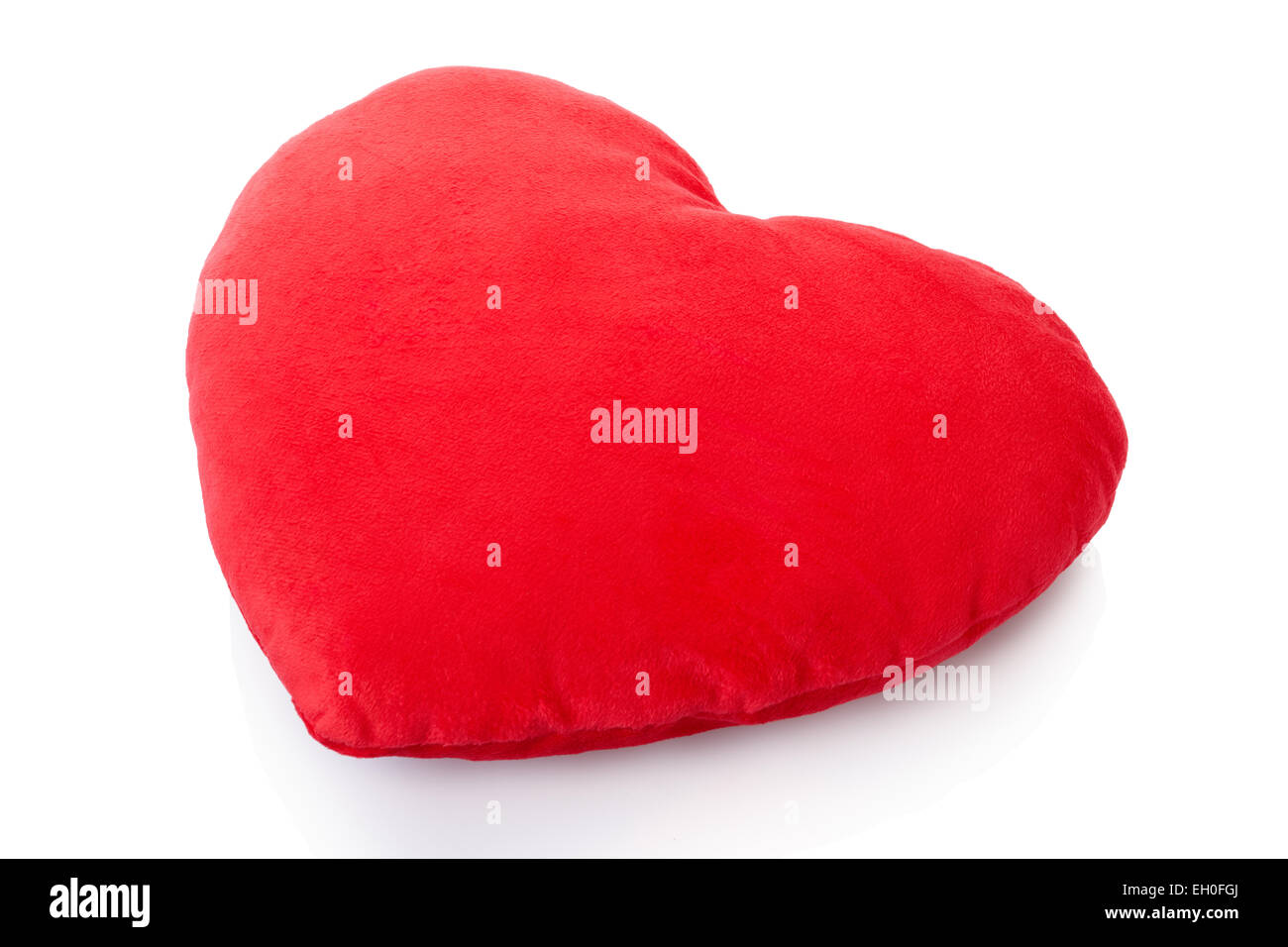 Heart red pillow, cushion isolated on white, clipping path included - Stock Image