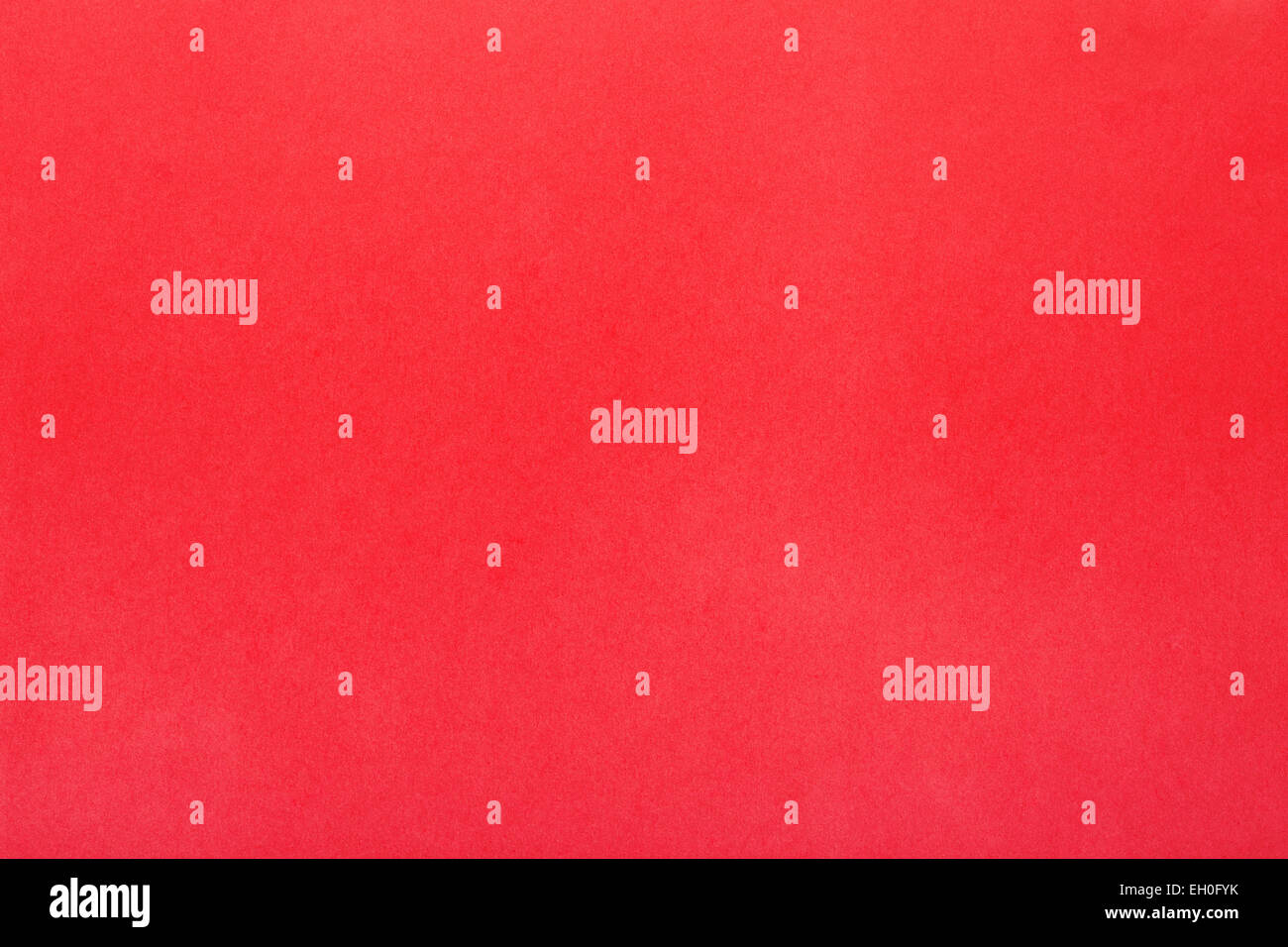Red background, simple paper texture - Stock Image