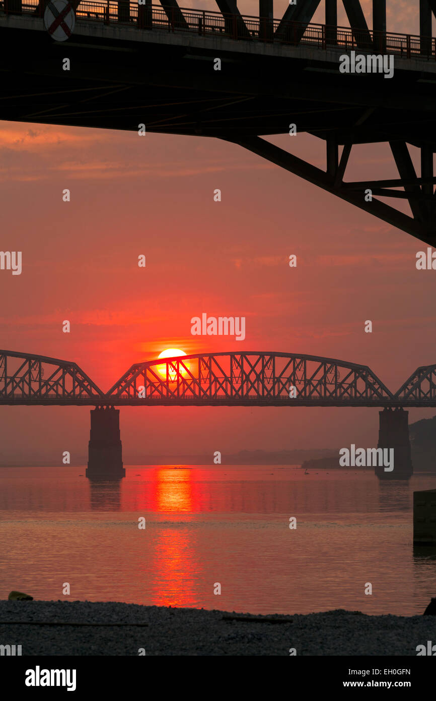 Sunset over the old railway bridge over the Irrawaddy river ( Ava bridge ) at Mandalay, Myanmar ( burma ), Asia - Stock Image