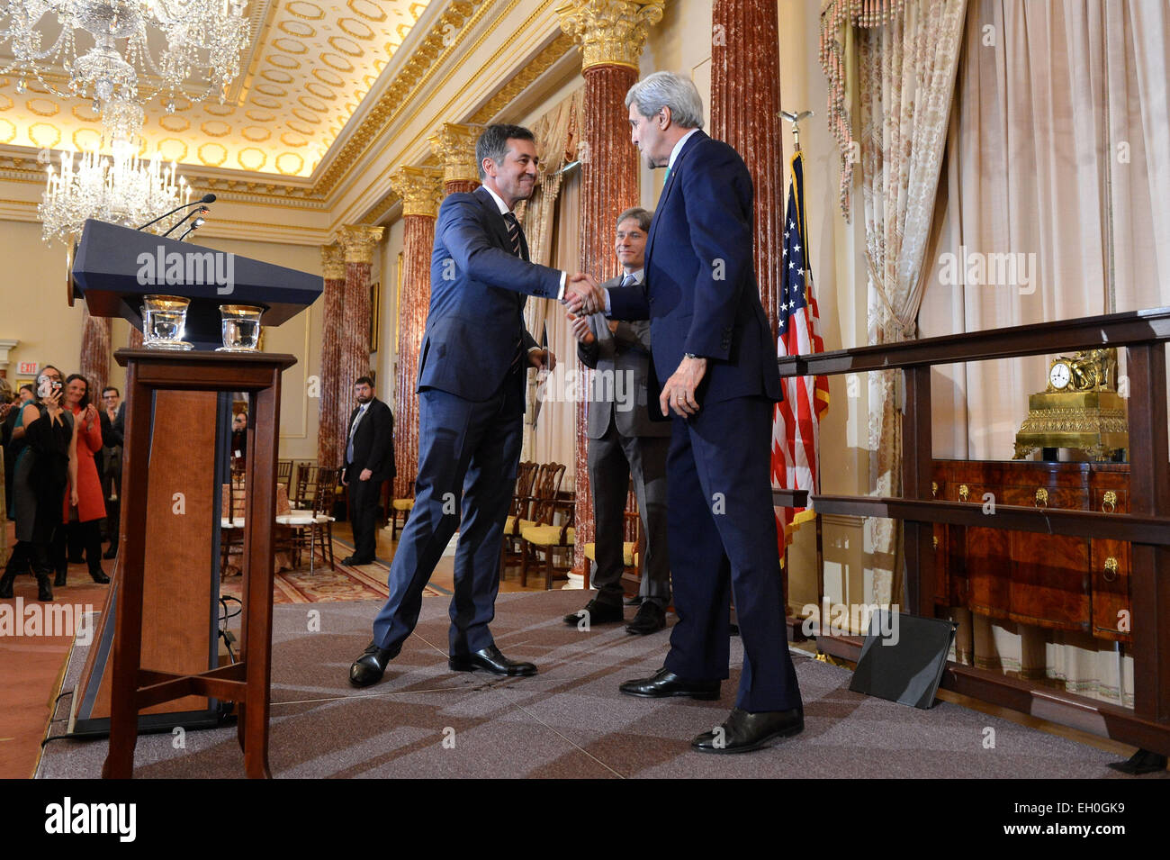 U.S. Secretary of State John Kerry congratulates Randy Berry as the first-ever Special Envoy for the Human Rights Stock Photo