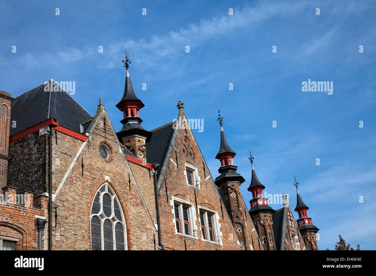 Fanciful architecture, much of it dating from the town's golden age (12th-15th centuries), gives Bruges its - Stock Image