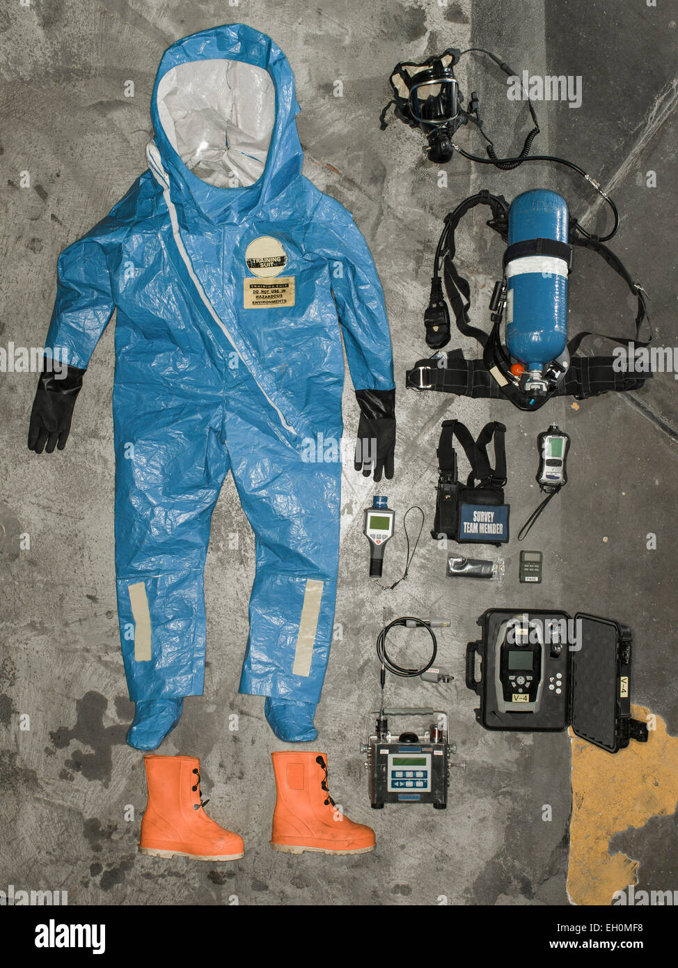 Nuclear radiation suit and accessories hangs on the wall. - Stock Image