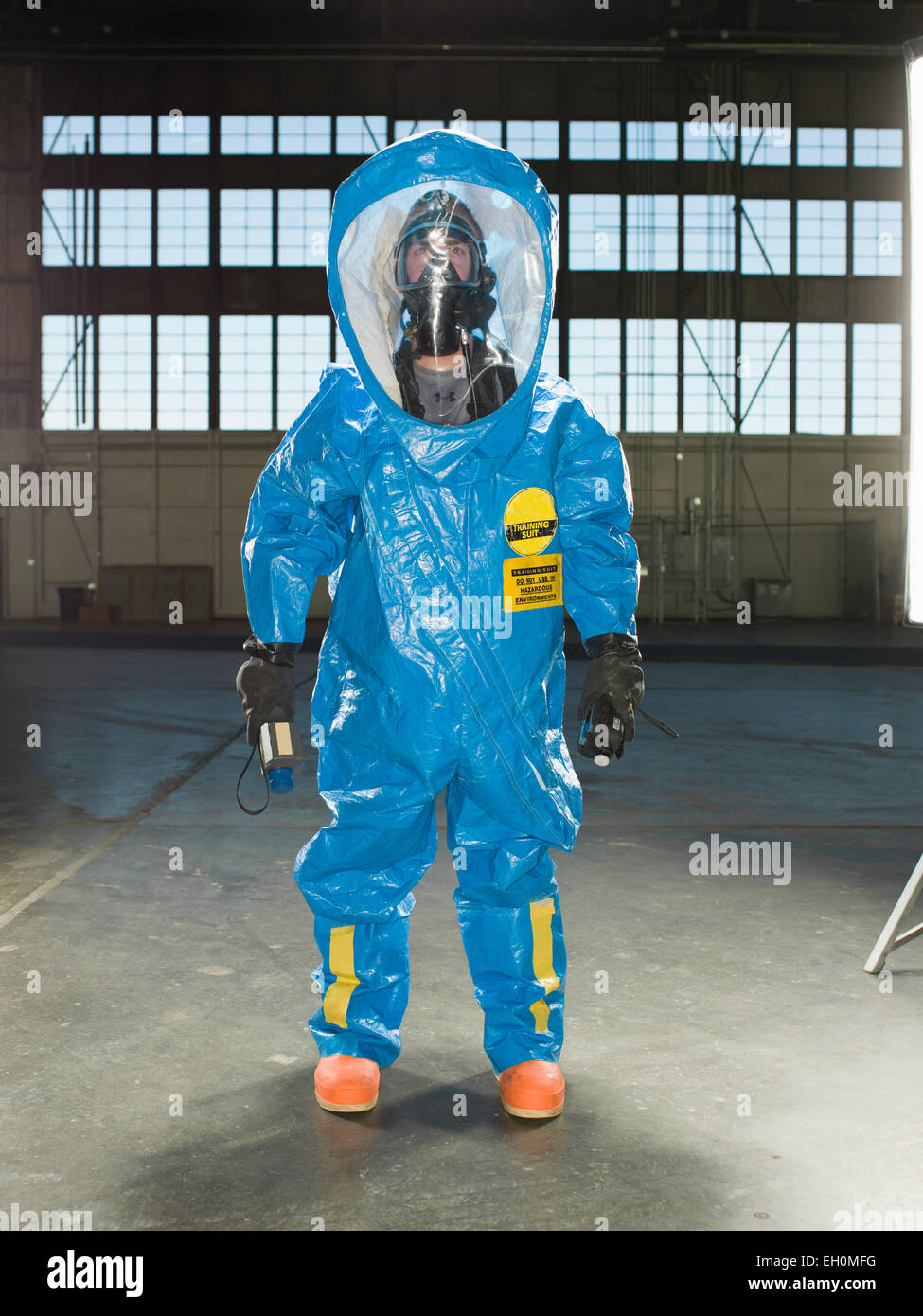 A National Guardsman wears a Nuclear radiation suit during training at an air base in South Dakota. - Stock Image