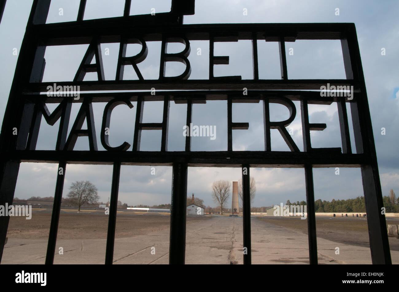 Arbeit Macht Frei sign on Sachsenhausen concentration camp memorial site, Oranienburg, Germany - Stock Image
