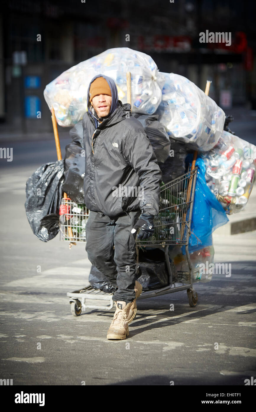 Man collects cans for recycling in Manhattan in New York North America USA - Stock Image