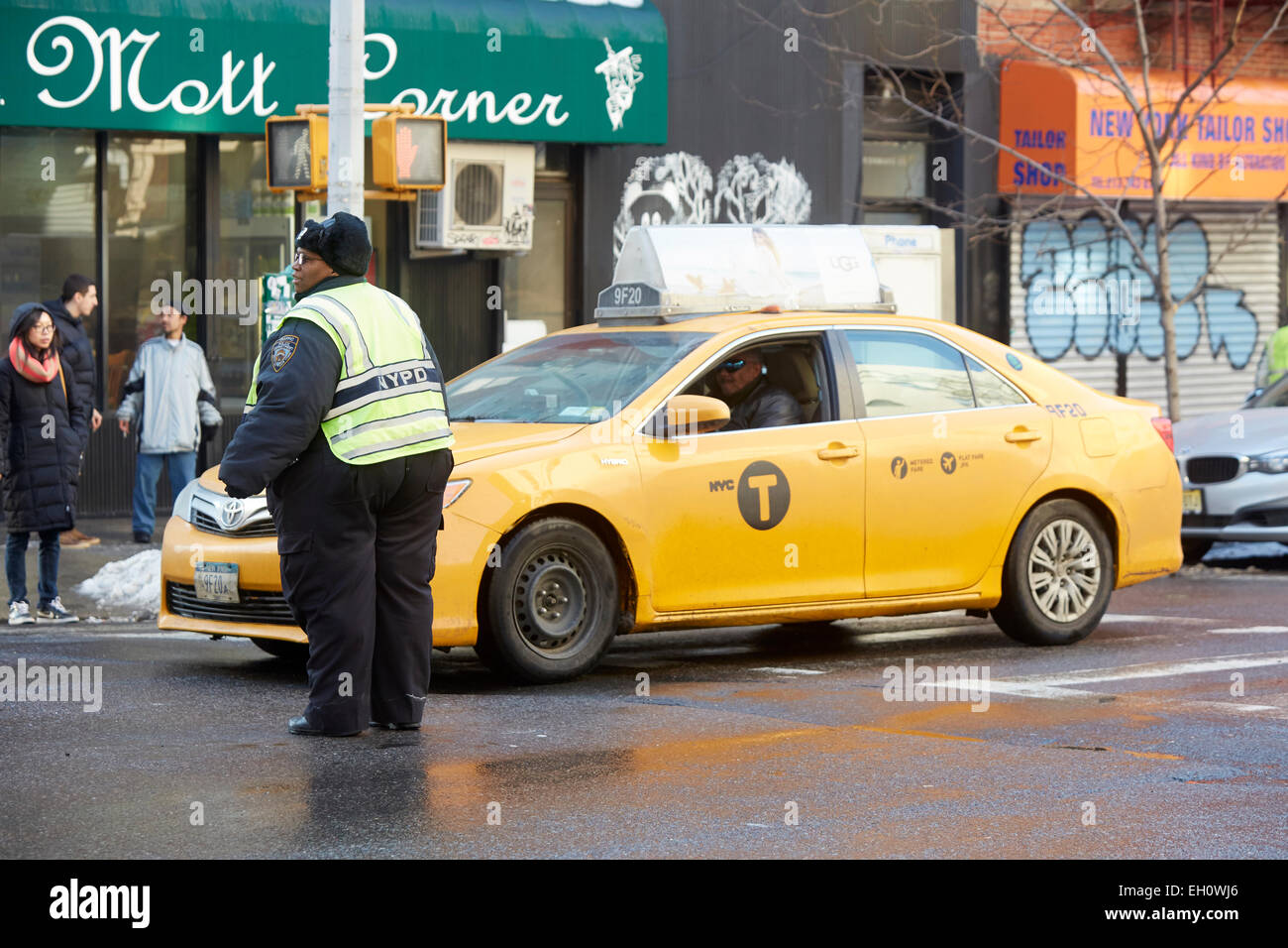 Large fat police officer doing traffic duty near Canal Street Manhattan in New York North America USA - Stock Image