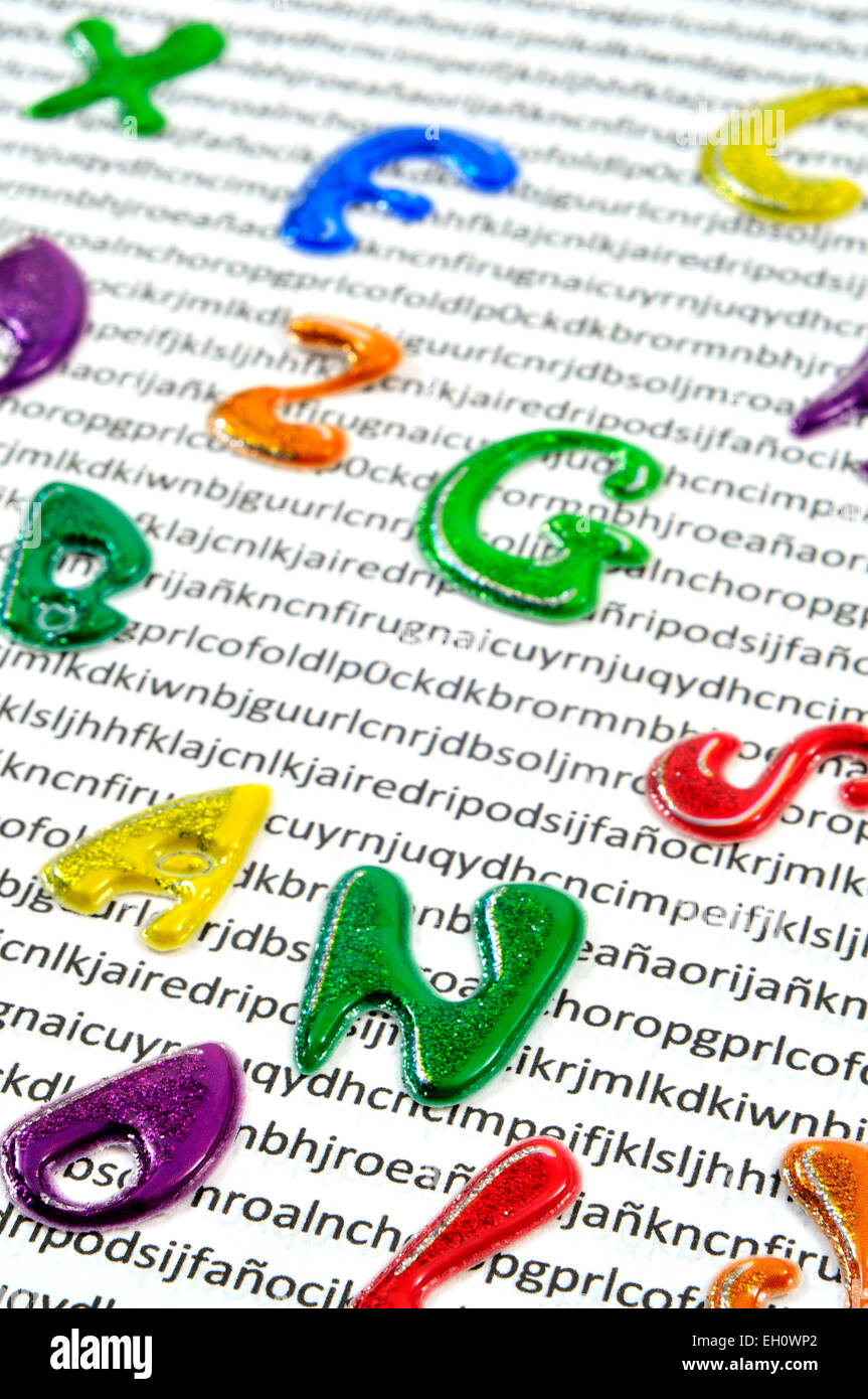 letters of different colors on a printed paper with nonsense words in the background, symbolizing the effect of - Stock Image