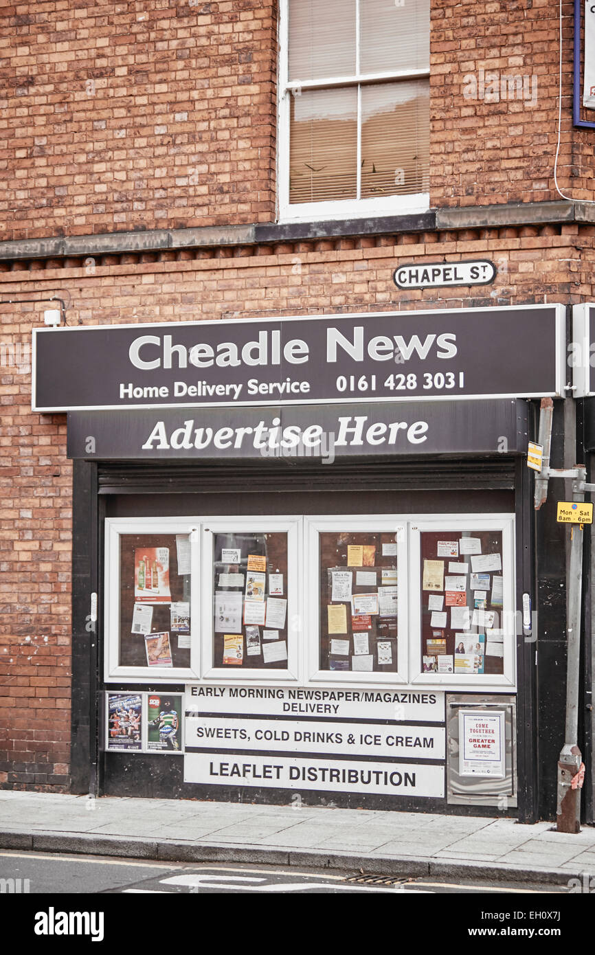 Cheadle Village newsagent Cheadle News in Stockport with a frames outside - Stock Image