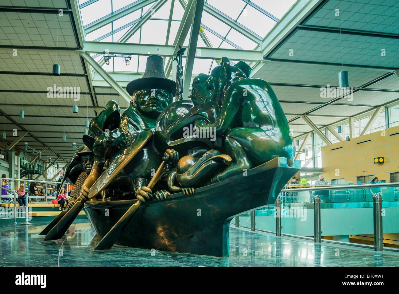Cast bronze sculpture, The Spirit of Haida Gwaii, the Jade Canoe, artist Bill Reid,  Vancouver Airport, YVR, Richmond, - Stock Image