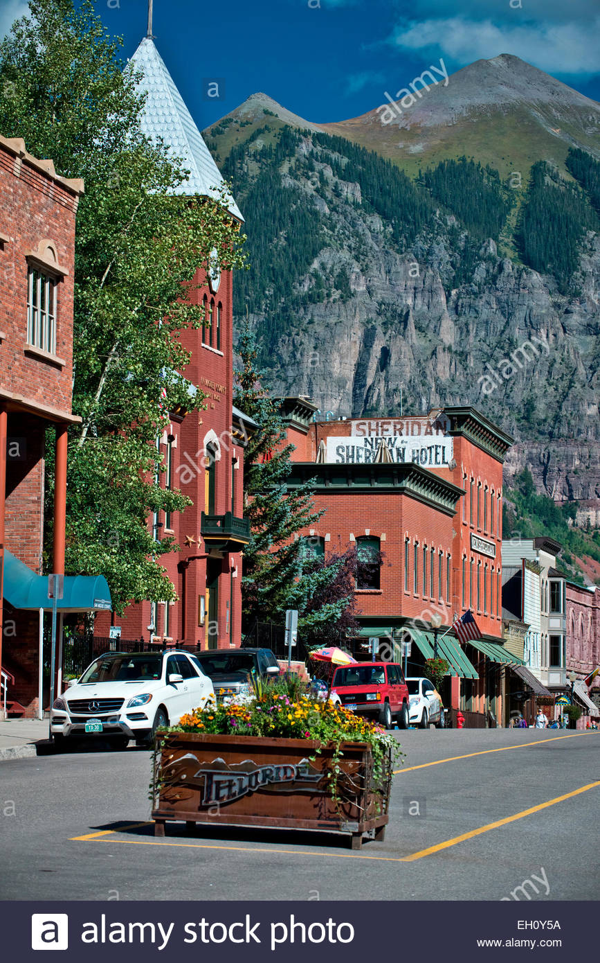 A street view of Telluride, Colorado and it's surrounding mountains on a summer day. - Stock Image