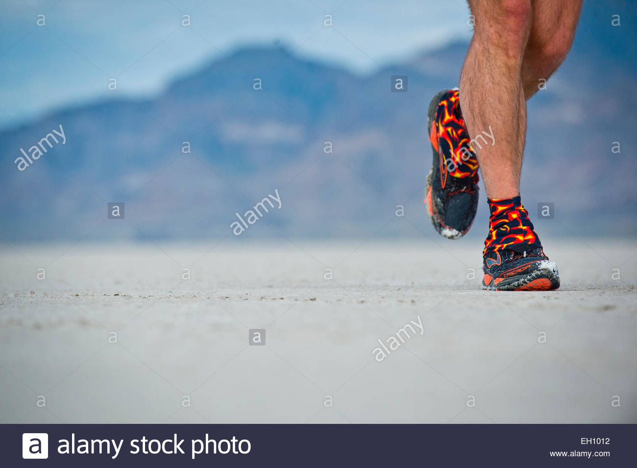 A close-up of a runners sneakers during the Slat Flats 100 in Bonneville, Utah. - Stock Image