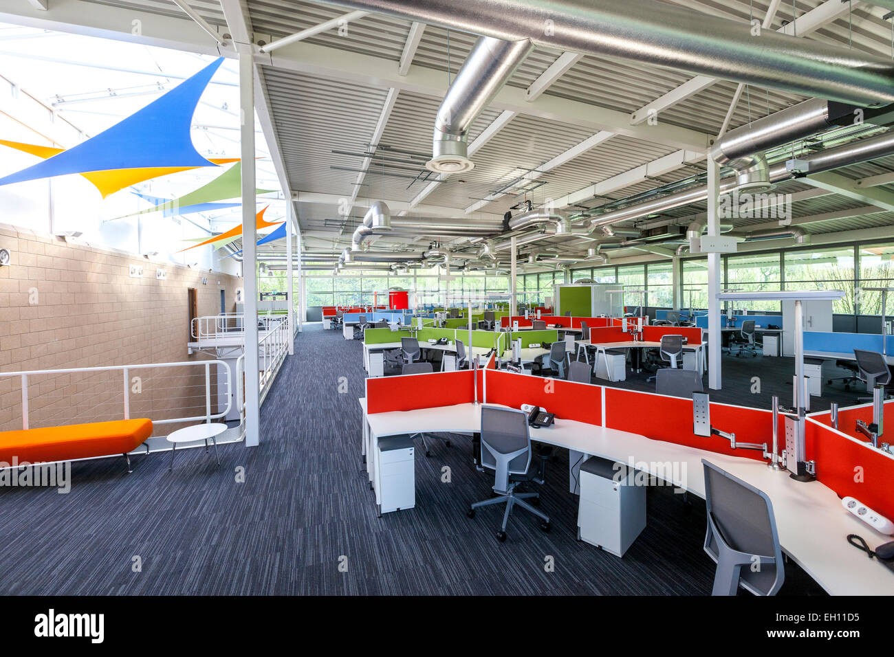 Modern office interior with open plan desking - Stock Image