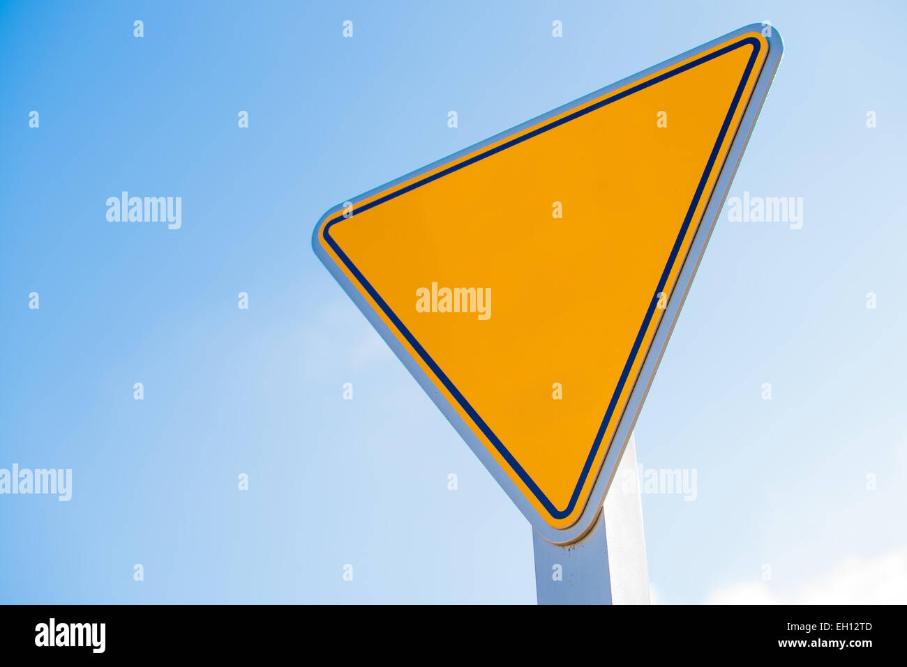 A blank yellow yield sign with copy space for text or graphics - Stock Image