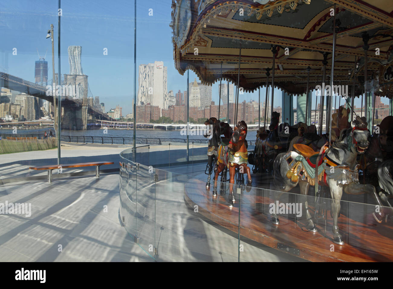 Jane's Carousel in Brooklyn Bridge Park with the Brooklyn Bridge in the background - Stock Image