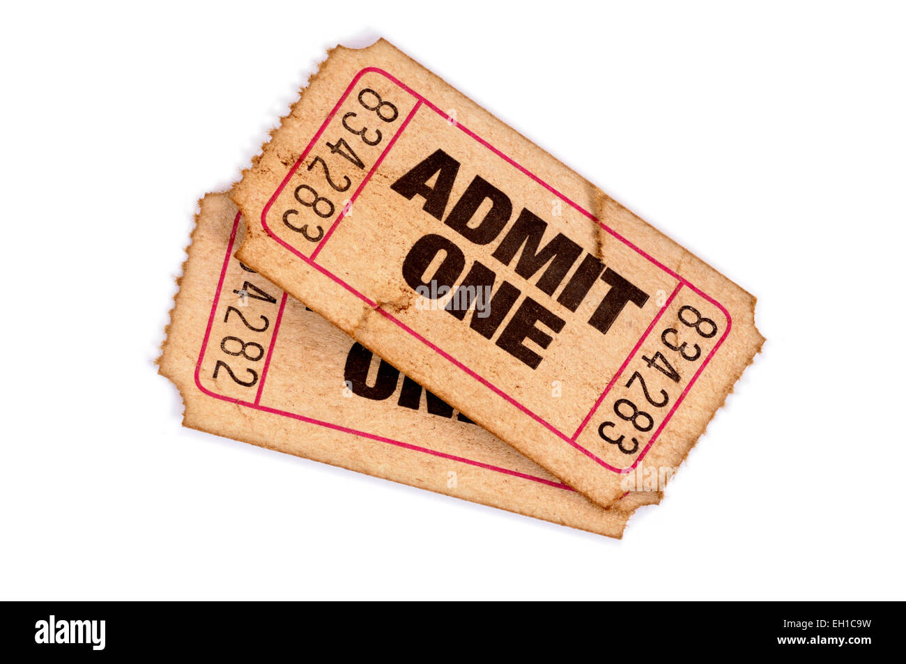 Two old torn movie tickets on a white background. - Stock Image