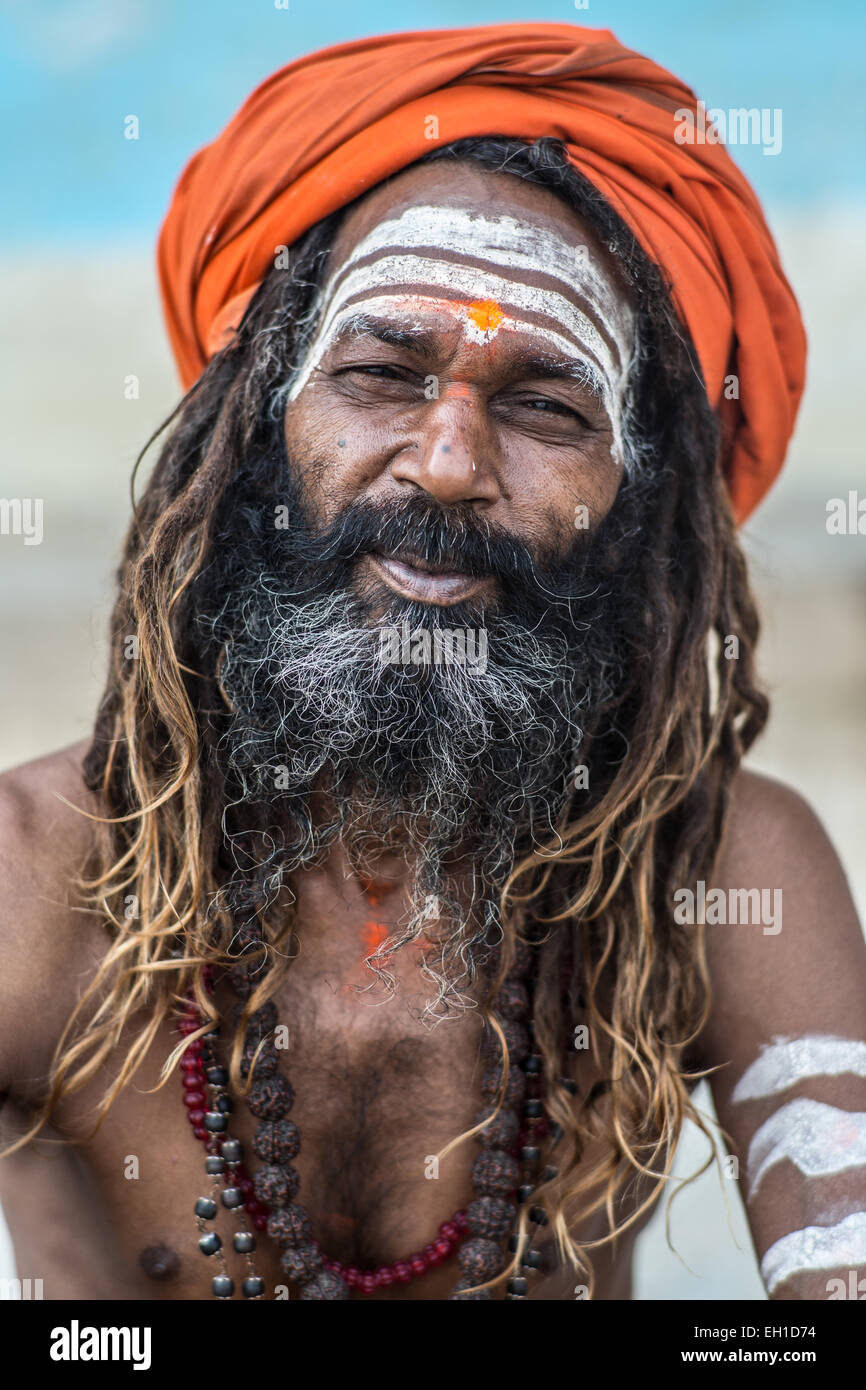 A portrait of a Hindu devotee known as a Sadhu with the characteristic orange head band and dreadlocks in the city Stock Photo
