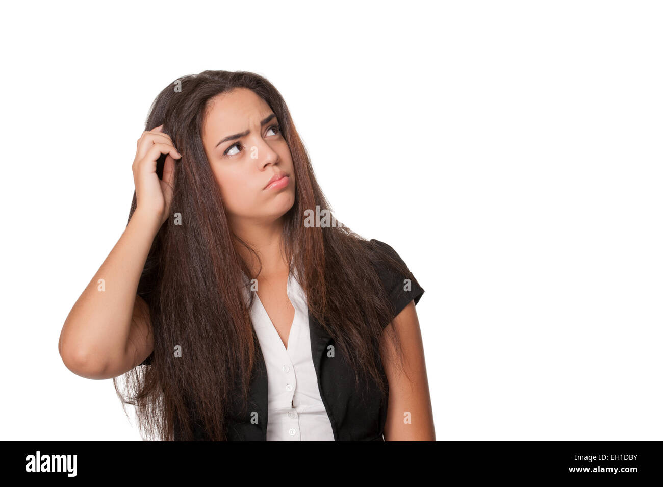 Portrait of puzzled young woman, isolated on white - Stock Image
